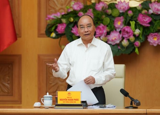 Thủ tướng Nguyễn Xuân Phúc chủ trì cuộc họp của Hội đồng Tư vấn chính sách tài chính, tièn tệ quốc gia ngày 9/7. Ảnh: VGP