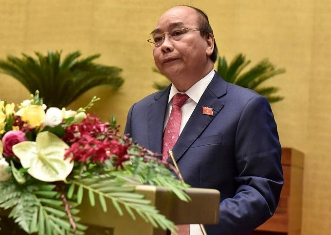 Thủ tướng Nguyễn Xuân Phúc báo cáo trước Quốc hội kết quả thực hiện kế hoạch phát triển kinh tế - xã hội 5 năm 2016-2020 sáng nay (20/10). Ảnh: Hoàng Phong.