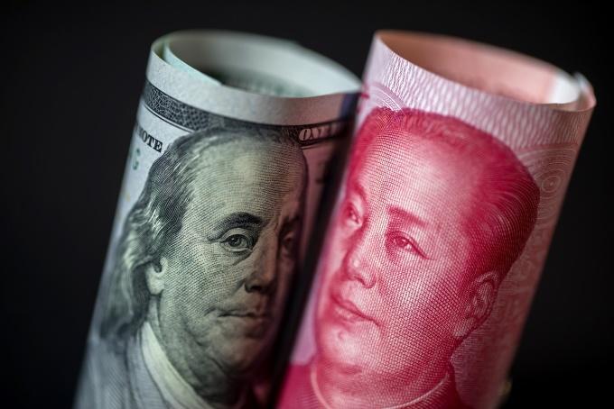 Tỷ giá CNY/USD - một trong những nguồn cơn gây ra cuộc chiến thương mại giữa Mỹ và Trung Quốc. Ảnh: Bloomberg.